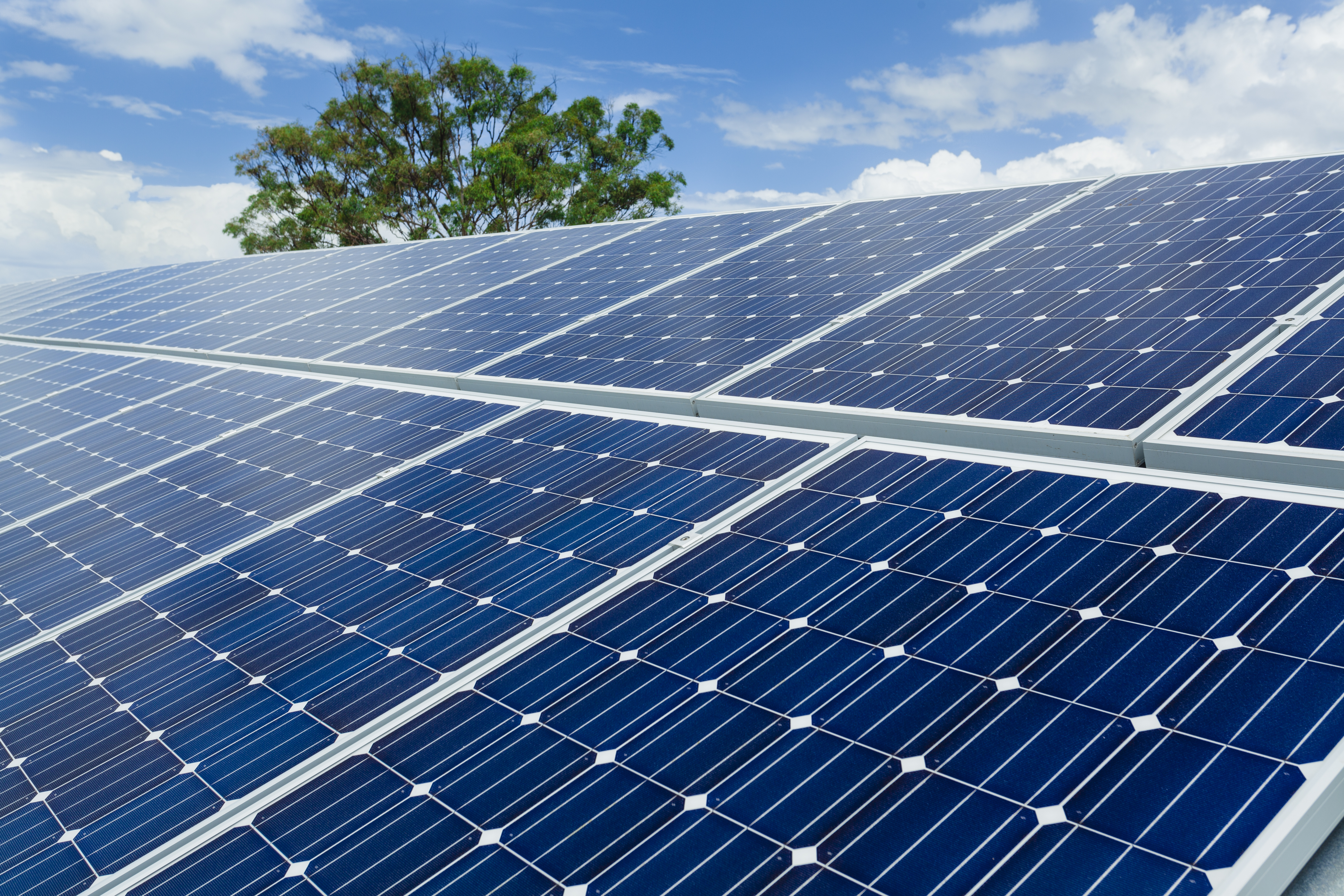 Solar-Panels-on-Factory-Roof-nice-sky-background_0